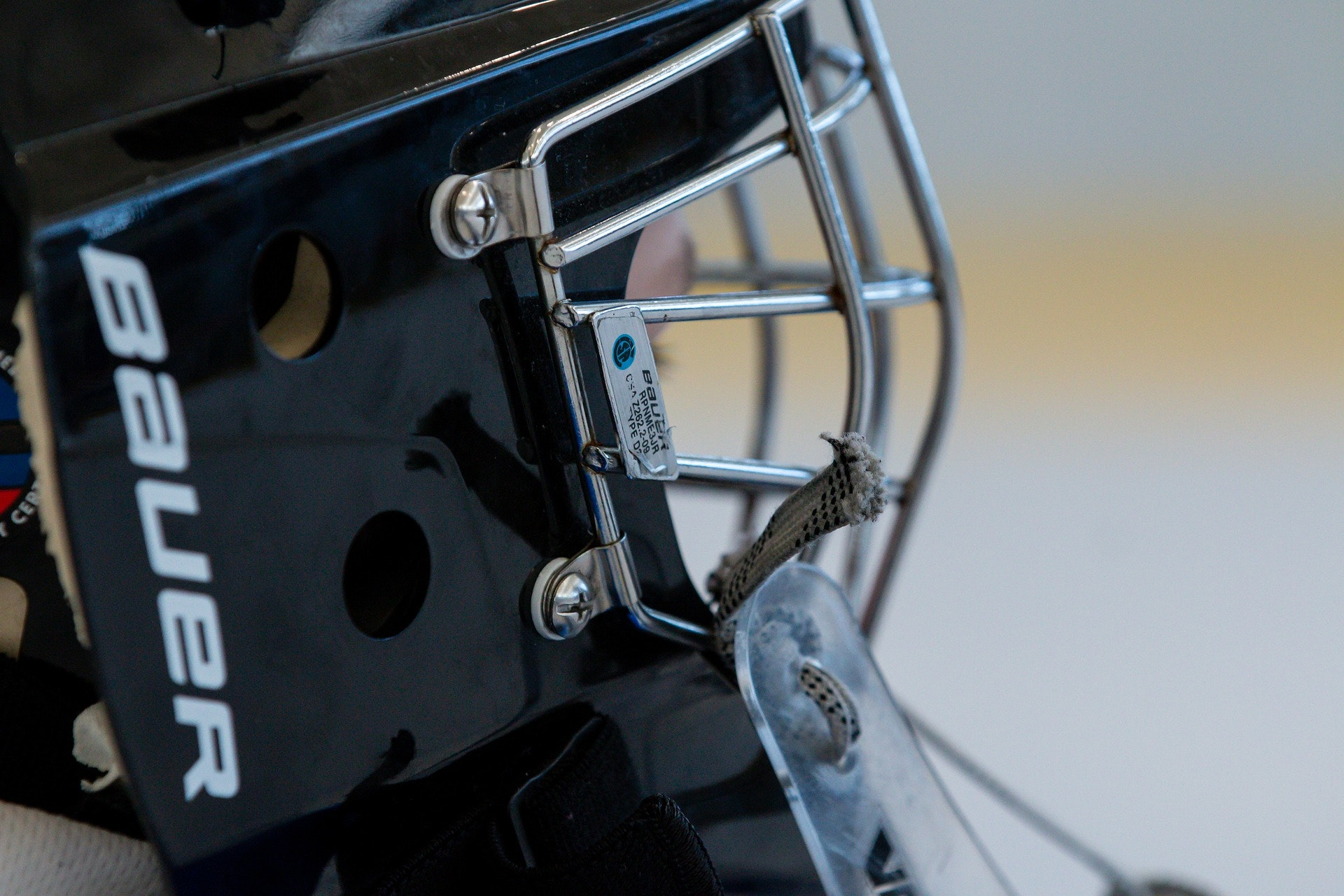 Ice hockey helmet with a face cage